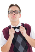 Nerdy hipster fixing his bow tie — Stock Photo