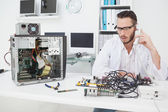 Computer engineer looking at broken device — Stock Photo