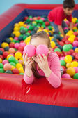 Happy girl playing in ball pool — Stock Photo