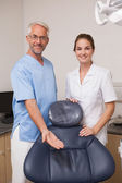 Dentist and assistant smiling at camera — Foto de Stock