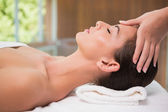 Attractive woman receiving head massage at spa center — Stock Photo