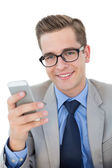 Nerdy businessman sending a text — Stock Photo