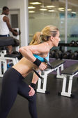 Side view of fit woman exercising with dumbbell in gym — Stock Photo