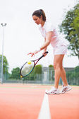 Tennis player playing a match on the court — Stock Photo