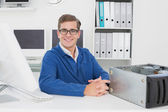 Smiling technician sitting at desk — Stock Photo
