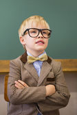 Pupil dressed up as teacher in classroom — Stock Photo