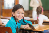 Pupil at her desk in classroom — Stock Photo