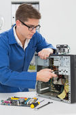 Young technician working on broken computer — Foto Stock
