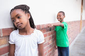 Pupil bullying another in the hall — Stockfoto