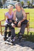 Active senior couple ready to go rollerblading  — Stock Photo