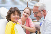 Boy with mother and dentist — Foto Stock