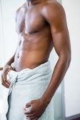 Shirtless muscular man in gym — Foto de Stock