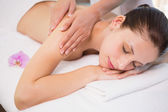 Attractive woman receiving shoulder massage at spa center — Stockfoto
