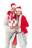 Festive couple holding presents and shopping bags — Stock Photo