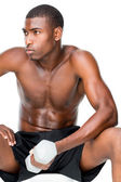 Determined fit man lifting dumbbell — Stock Photo
