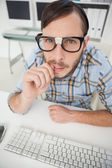 Nerdy nervous businessman working on computer — Stock Photo