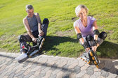 Active senior couple ready to go rollerblading  — Stock Photo