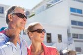 Happy senior couple holding shopping bags — Foto Stock