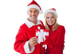 Festive couple smiling and holding gift — Стоковое фото