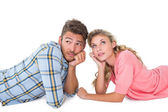 Attractive young couple lying and thinking — Stock Photo