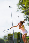 Pretty tennis player about to serve — Stock Photo