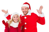 Festive couple smiling with arms raised — Stock Photo