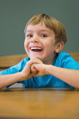 Pupil sitting at desk in classroom — Stock Photo