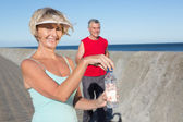 Active senior couple out for a jog — Stock Photo
