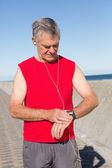 Active senior man jogging on the pier — Stock Photo