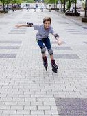 Shot of smiling sliding rollerskater in protection kit — Stock Photo