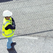 Standing worker on road works; horizontal orientation - Stock Photo