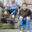 Two smiling teenage boys in roller-blading protection kits — Stock Photo