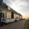 Holland, Volendam village, typical old dutch houses into the sun — Stock Photo