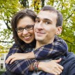Portrait of love couple embracing outdoor in park looking happy — Stock Photo #13914072