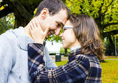 Portrait of love couple embracing outdoor looking happy — 图库照片