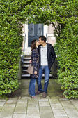 Portrait of love kissing couple embracing outdoor looking happy — Stock Photo