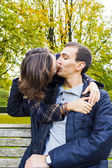 Love couple closeup kissing looking happy — Stock Photo