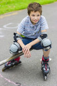 Portrait of smiling rollerskater in protection kit — Stock Photo
