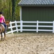 Young girl riding a running horse - Stock Photo