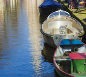 Modern boats on the canal of Amsterdam — Stock Photo