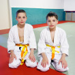 Boys in sports hall is engaged in judo — Stockfoto