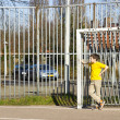Royalty-Free Stock Photo: Cute boy staying in gate on the playground