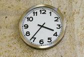 Metal clock on the wall — Stock Photo