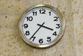 Metal clock on the wall — Stock Photo