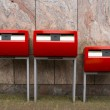 Three red public mailboxes with two slots, common in the Netherl - Stock Photo