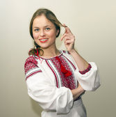 Portrait of beautiful young woman in the Ukrainian national clothes — Stock Photo