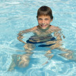 Activities on the pool. Cute boy swimming and playing in water i — Stock Photo