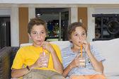 Adorable boys with glasses of milkshake — Stock Photo