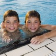 Activities on the pool. Cute boys swimming and playing in water — Stock Photo #26014507