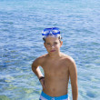 Cute eleven years old boy staying in sea — Stock Photo #26150169
